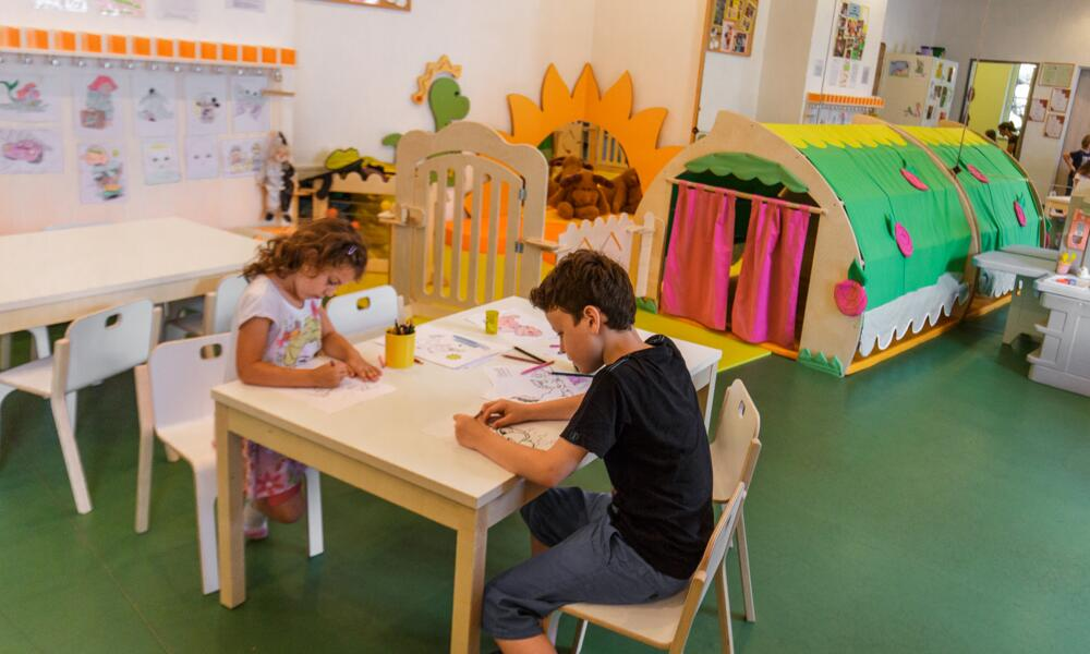 Children drawing in the children's play room