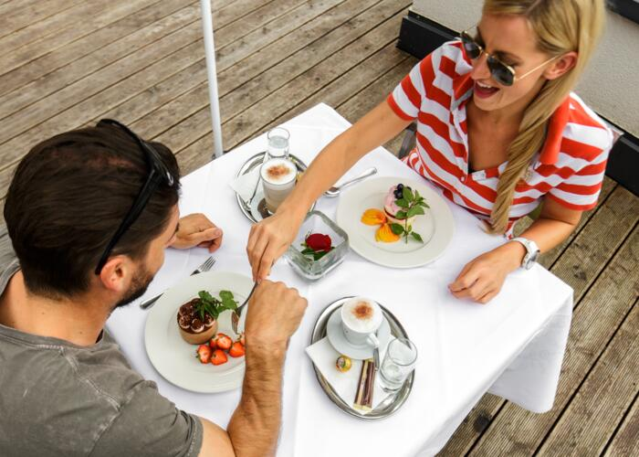 Couple enjoys lunch on the sun terrace
