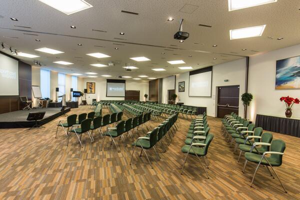 Large seminar room with seating and stage